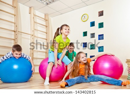 Laughing kids in a gym - stock photo