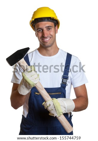 Laughing latin worker with a sledgehammer - stock photo