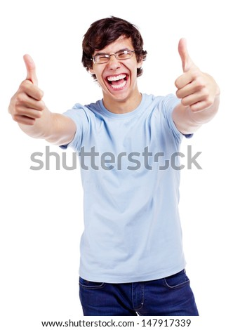 Laughing latin young man in glasses, blue shirt and jeans showing thumb up with both hands. Isolated on white background, mask included