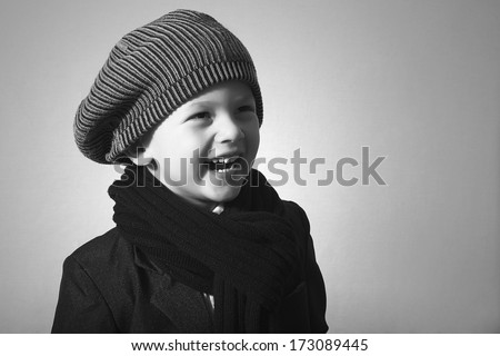 Laughing little boy in cap style kid fashion children handsome