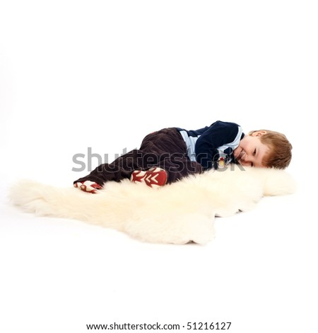 Laughing little boy laying on floor