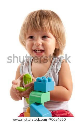 Laughing little boy playing with blocks, isolated on white background - stock photo
