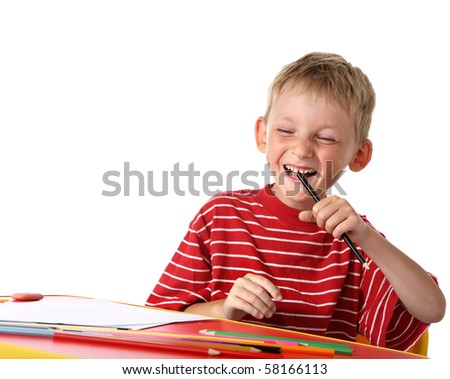 Laughing little boy with colored pencils - stock photo