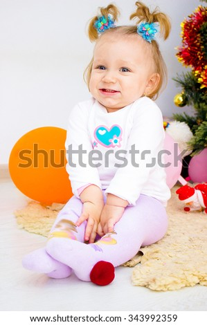 laughing little girl at room
