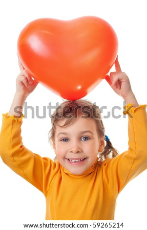 laughing little girl holds over her head heart shape balloon isolated on white background - stock photo