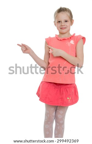 Laughing little girl in a pink t-shirt with short sleeves and short skirt shows hands the direction in the direction of a larger plan-Isolated on white background - stock photo