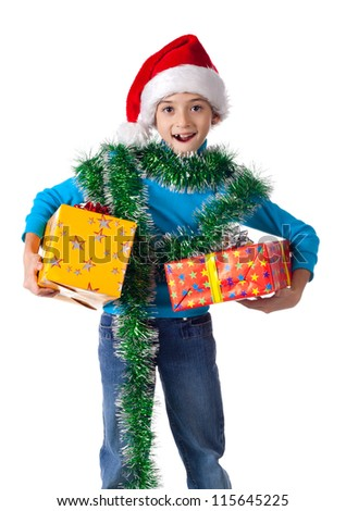 Laughing little girl in Santa's hat with gift boxes, isolated on white - stock photo