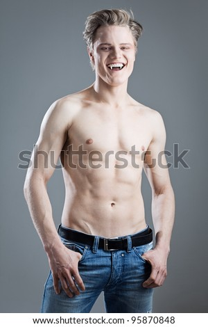 Laughing male vampire on gray background - stock photo