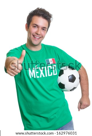 Laughing mexican soccer fan with ball showing thumb - stock photo