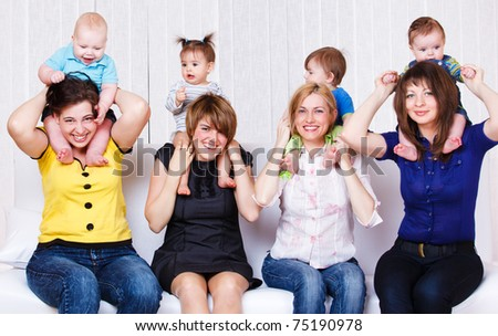 Laughing mothers and their children - stock photo
