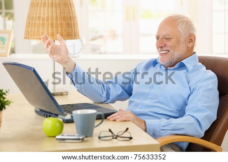 stock photo laughing old man using laptop computer at home looking at screen gesturing 75633352 laughing old man using laptop computer stock photo 75633352