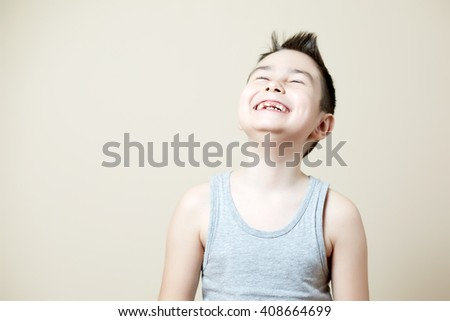 laughing out loud boy emotion - stock photo