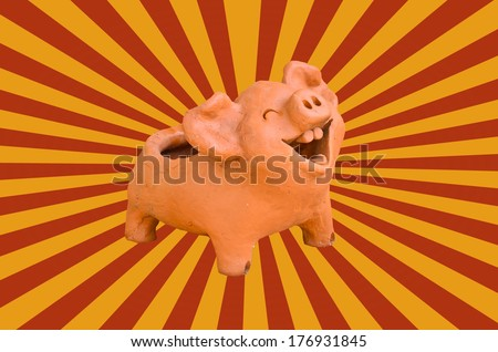 Laughing pig statue on sun beam vintage - stock photo