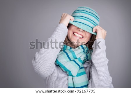Laughing playful woman - stock photo