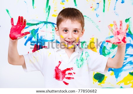 Laughing preschool boy, over painted background - stock photo