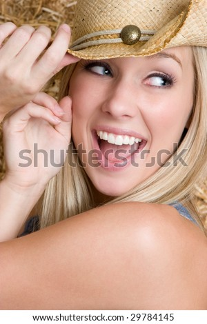 Laughing Pretty Cowgirl - stock photo