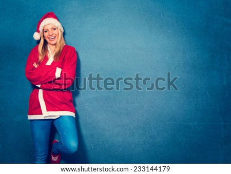 laughing Santagirl in front of a blue wall - Santagirl - stock photo