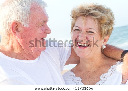 laughing senior couple closeup - stock photo