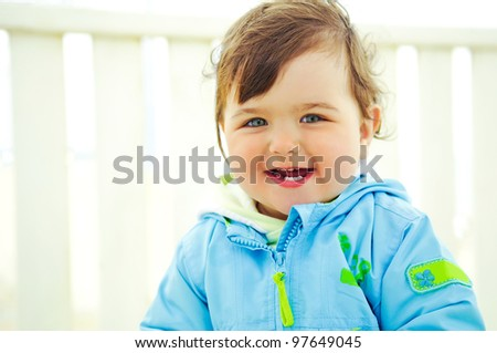 laughing small kid on a white background - stock photo