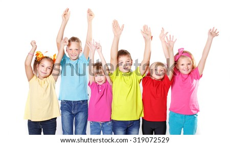 laughing small kids on a white background with hands up position - stock photo