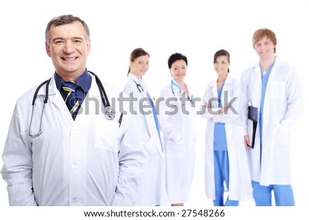laughing successful mature male doctor with his colleagues