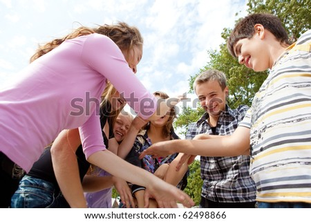 Laughing teens playing - stock photo
