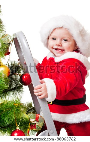 Laughing toddler on step ladder, decorating Christmas tree - stock photo