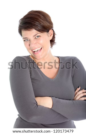 Laughing vivacious attractive woman standing with her arms folded isolated on white - stock photo