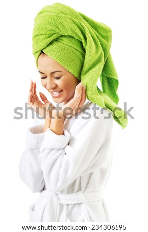 Laughing woman in bathrobe and towel on head. - stock photo