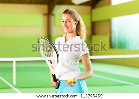 Laughing woman look forward to playing tennis in a court indoors