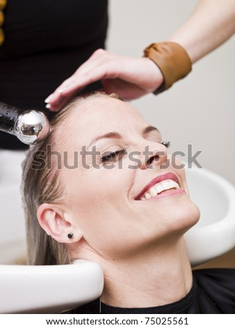 Laughing woman relaxing at the Beauty spa