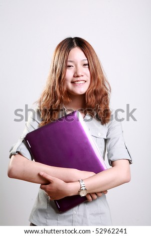 Laughing woman using a laptop  against a white background