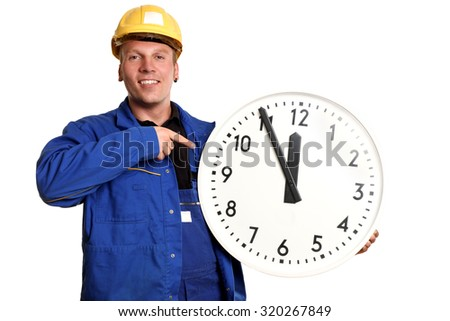 Laughing worker holding big clock  - stock photo