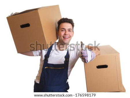 Laughing worker with a box on his shoulder showing thumb up - stock photo
