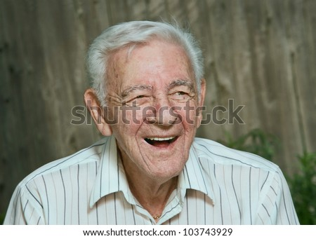 Laughing 90 year old senior man candid portrait - stock photo