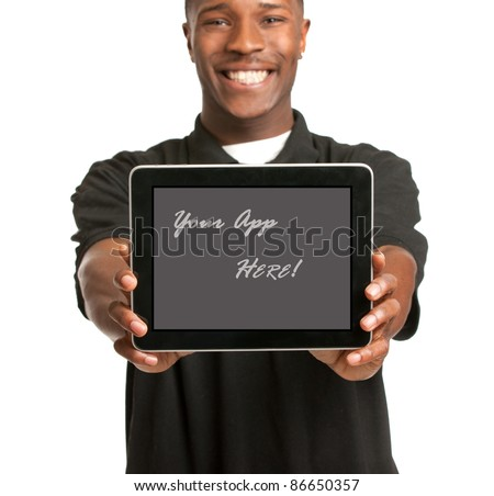 Laughing Young African American Male Holding a Touch Pad Tablet PC on Isolated White Background - stock photo