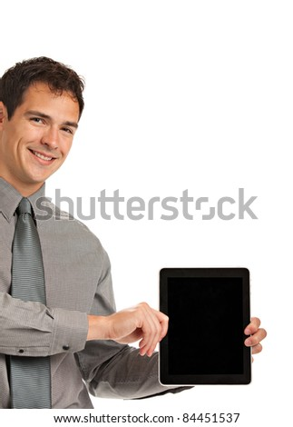 Laughing Young Businessman Holding a Touch Pad Tablet PC on Isolated White Background - stock photo