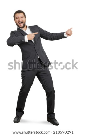 laughing young businessman in suit pointing at something and screaming. isolated on white background - stock photo