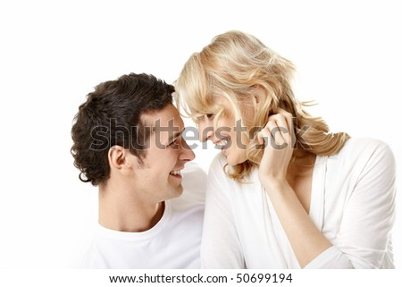 Laughing young couple on a white background - stock photo