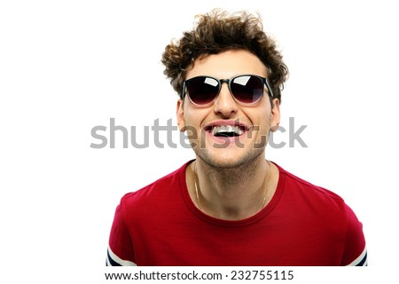 Laughing young fashion man with sunglasses on a white backgorund - stock photo