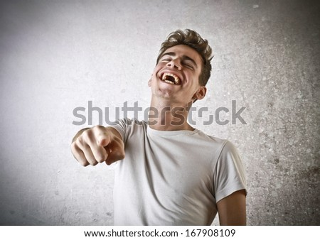 Laughing Young Guy - stock photo
