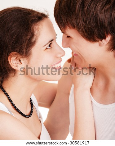 Laughing young man and girl on white background