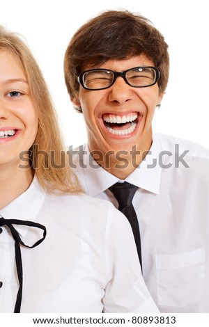 Laughing young man and half face of smiling pretty girl in white shirts and black ties over white isolated background - stock photo