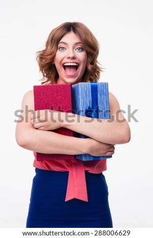 Laughing young woman hugging gift isolated on a white background - stock photo