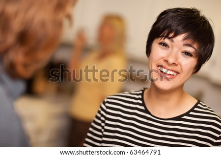 Laughing Young Woman Socializing in a Party Setting. - stock photo
