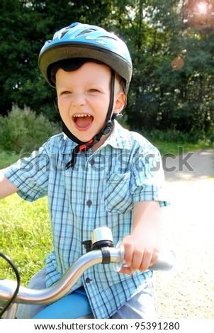 Lauging Child with bike - stock photo