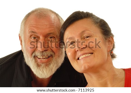 Lauging senior couple enjoying life; a happy, candid shot of the two older people laughing