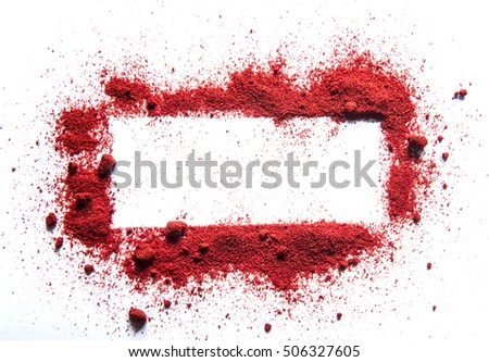 Launched orange powder on white background. Chili or curry