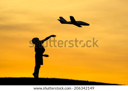 Launching a toy plane. - stock photo