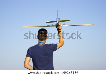 Launching radio controlled airplane - stock photo